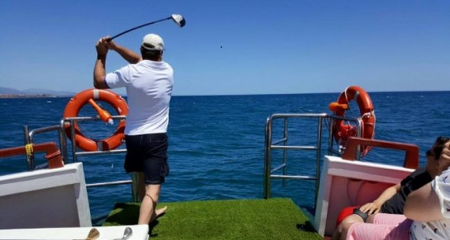 golf at sea from a boat in marbs